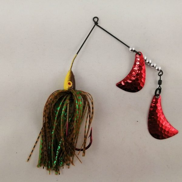 Brown and yellow spinnerbait with red hatchet blades