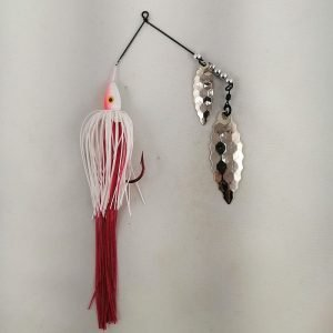 Red and white spinnerbait with a long bleeder skirt, and scallop blades