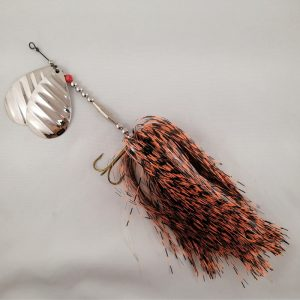 Black and orange barred inline spinner with double 10 blades and two sets of treblehooks